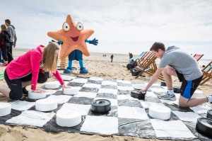 Students from llandarcy College enjoy the beach games at the Marks and Spencer Big Beach Clean-Up in Swansea Bay.